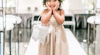 flower girl in the ella ballroom banquet hall at noor in los angeles