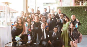 wedding guests smiling and waving on the sofia banquet hall balcony at noor los angeles