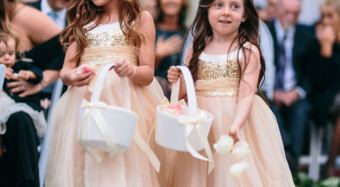 two flower girls in blush dresses at a wedding ceremony on the terrace at noor los angeles