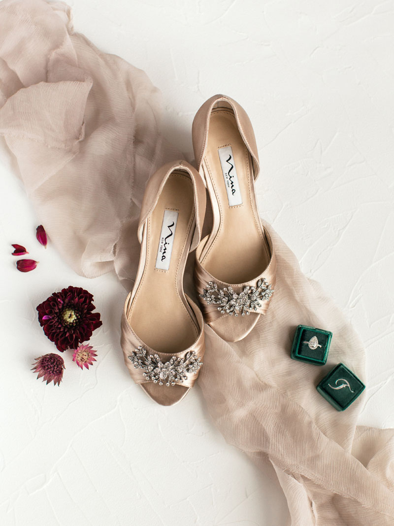 wedding details nina shoes with custom ring box and flowers