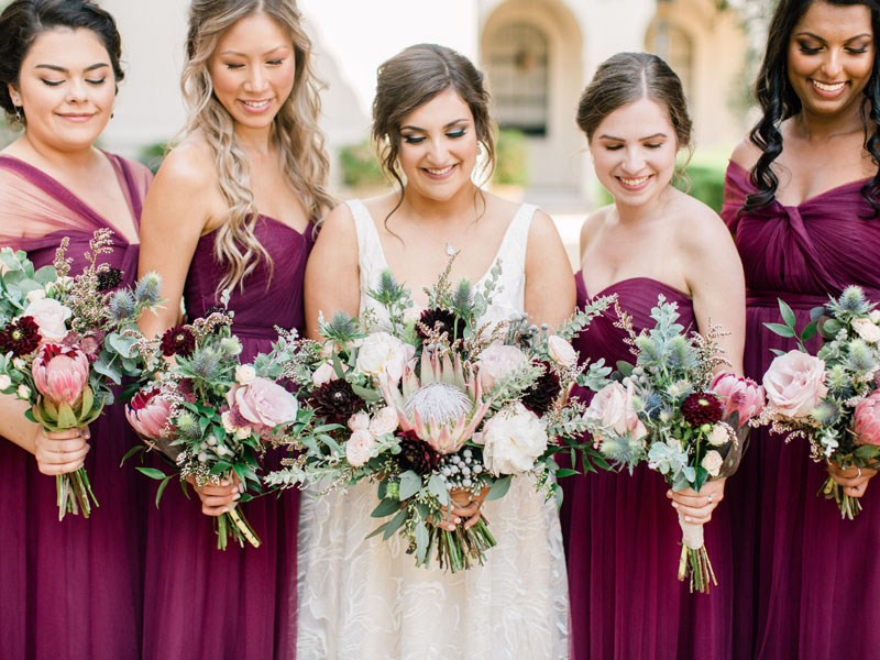 NOOR bride and her bridesmaids in burgundy with beautiful matching bouquets