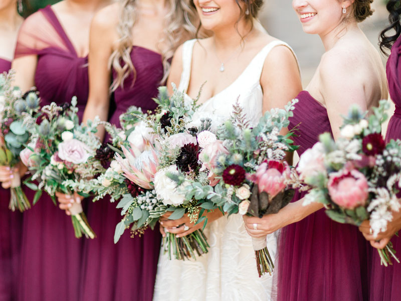bride and bridesmaids with bouquets at los angeles wedding venue