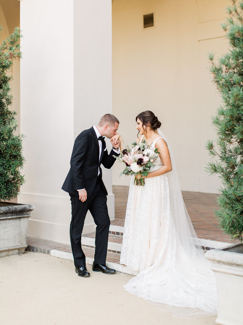 los angeles wedding groom kisses the brides hand in a beautiful first look moment