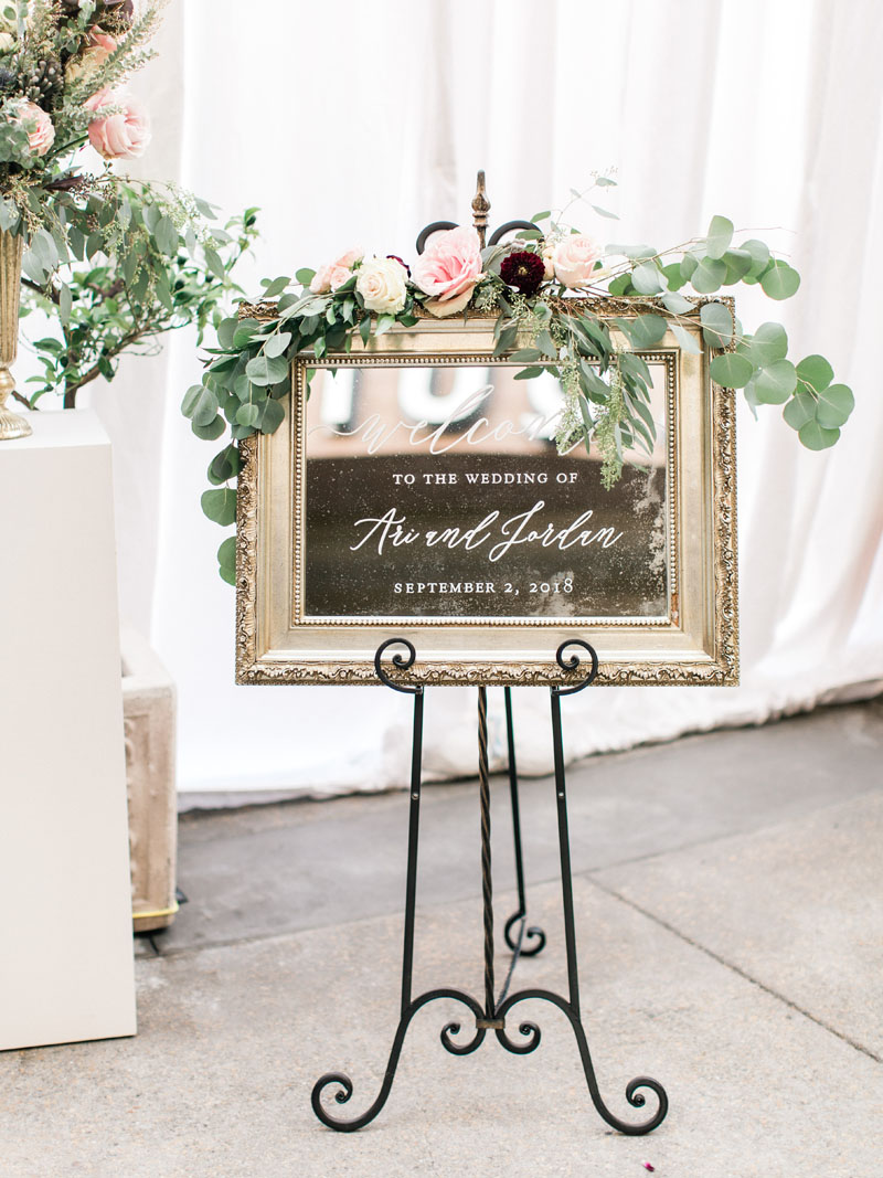 wedding welcome sign in calligraphy on an antique mirror