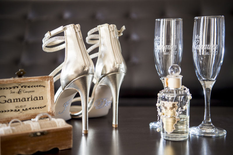 bridal shoes, champagne glasses, perfume and other bridal details