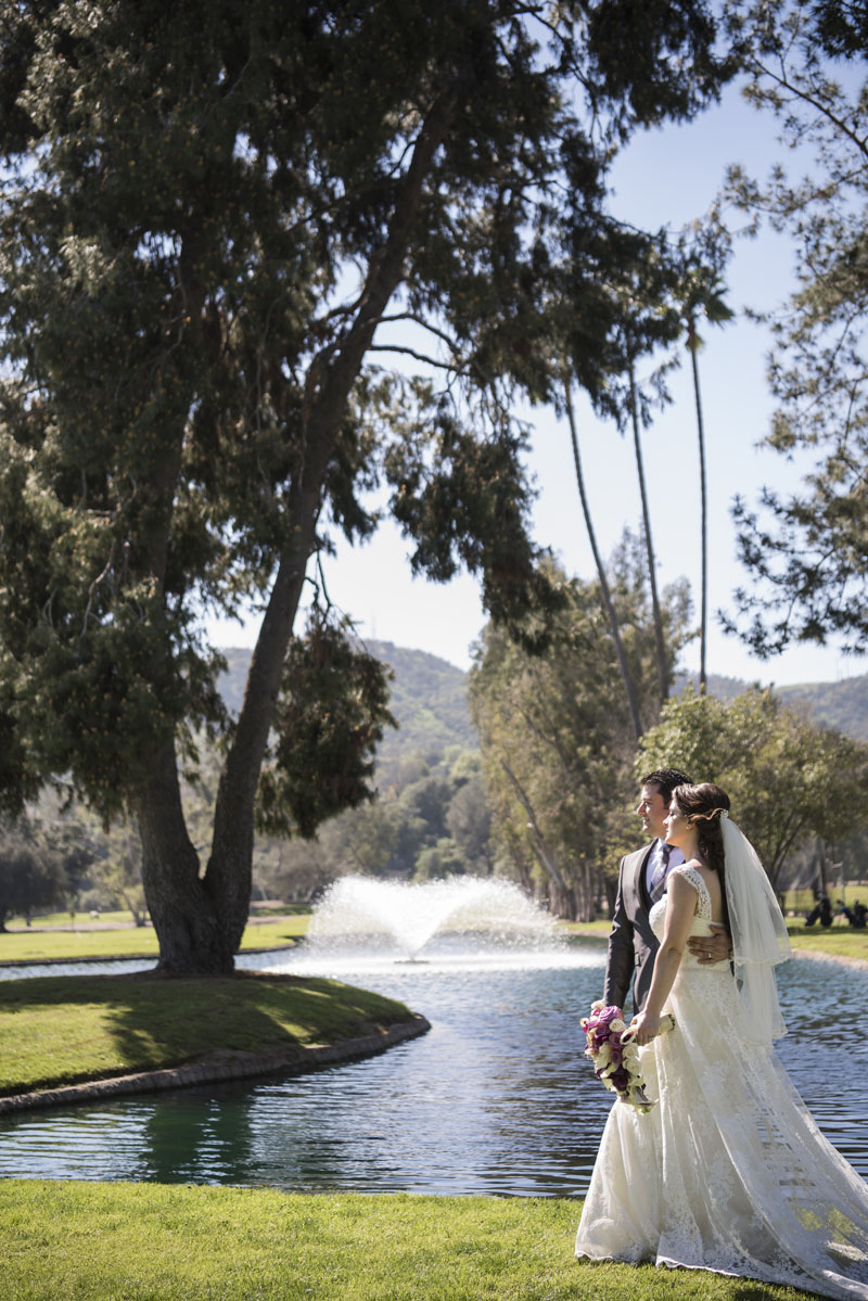 bride and groom walking by a fountain los angeles wedding