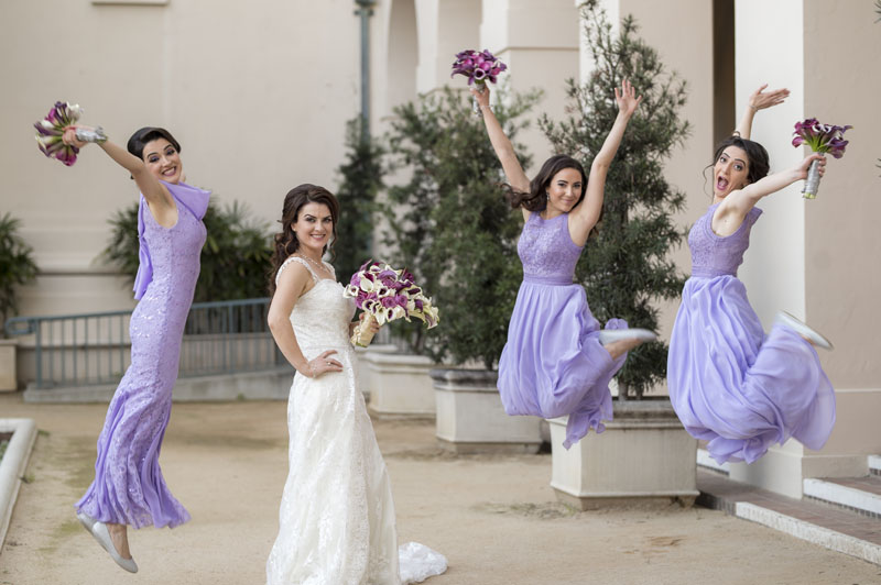 bride and bridesmaids jumping for joy los angeles wedding
