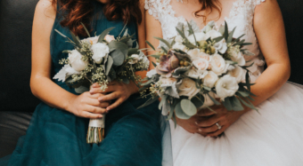 bride and bridesmaid with bouquets seated in the ella foyer at noor los angeles