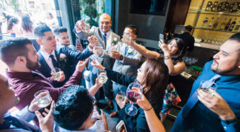 wedding guests with drinks in the ella bar and foyer at noor los angeles