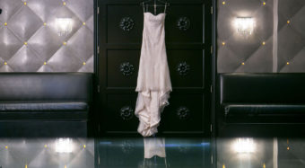 wedding dress hung artistically on the ella banquet hall doors at noor los angeles