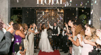 bride and groom making grand exit with bubbles outside the ella banquet hall