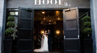 romantic wedding portrait of bride and groom at the entrance to ella banquet hall