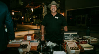 cigar rolling table on the ella banquet hall patio for a wedding reception
