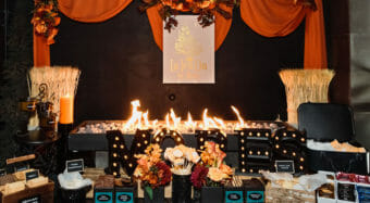 la tea dar by ruth smores station with drapes and flowers at the noor wedding show