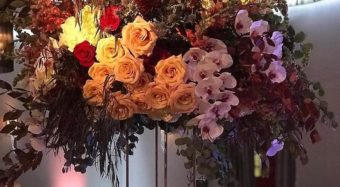large floral arrangement at the fall soiree wedding show in the ella ballroom at noor los angeles