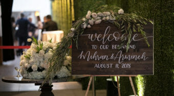 wedding decor welcome sign with floral arrangement