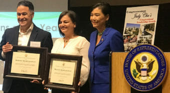 congresswoman judy chu presenting awards to robbert and maggie shahnazarian