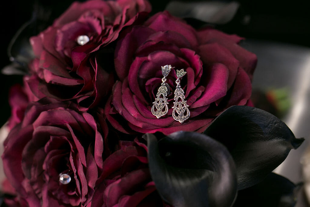 wedding jewelry and red rose wedding bouquet