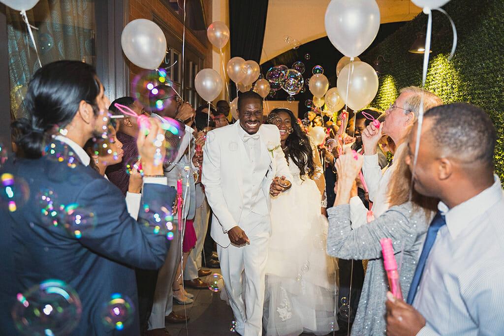 bride and groom balloons and bubbles exit at NOOR pasadena banquet halls in pasadena