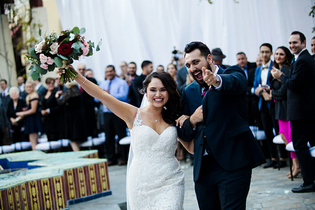 bride and groom celebrating just after exchanging vows on the terrace garden courtyard at NOOR banquet halls in pasadena