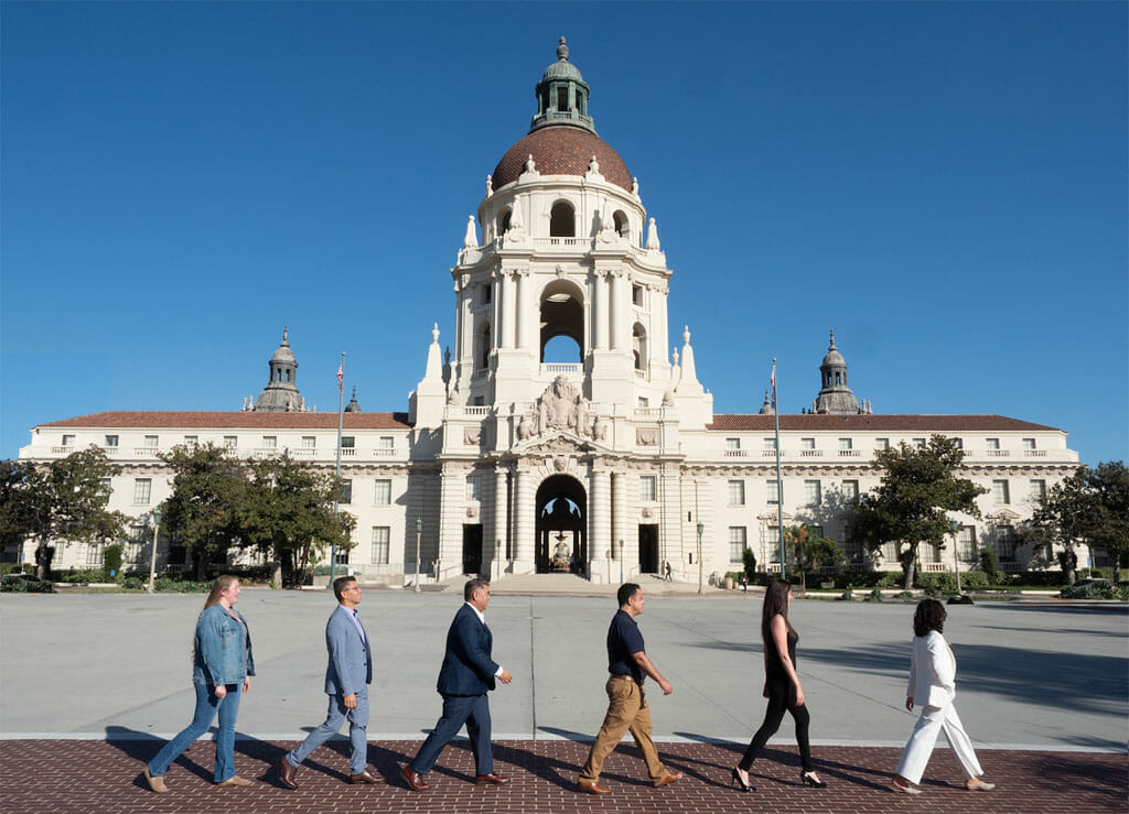noor los angeles event management team walking in front of pasadena city hall