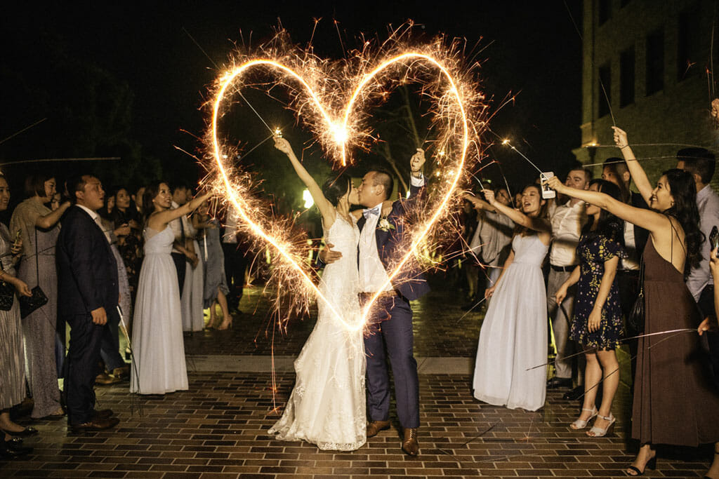 wedding sparkler couple drawing heart in the air