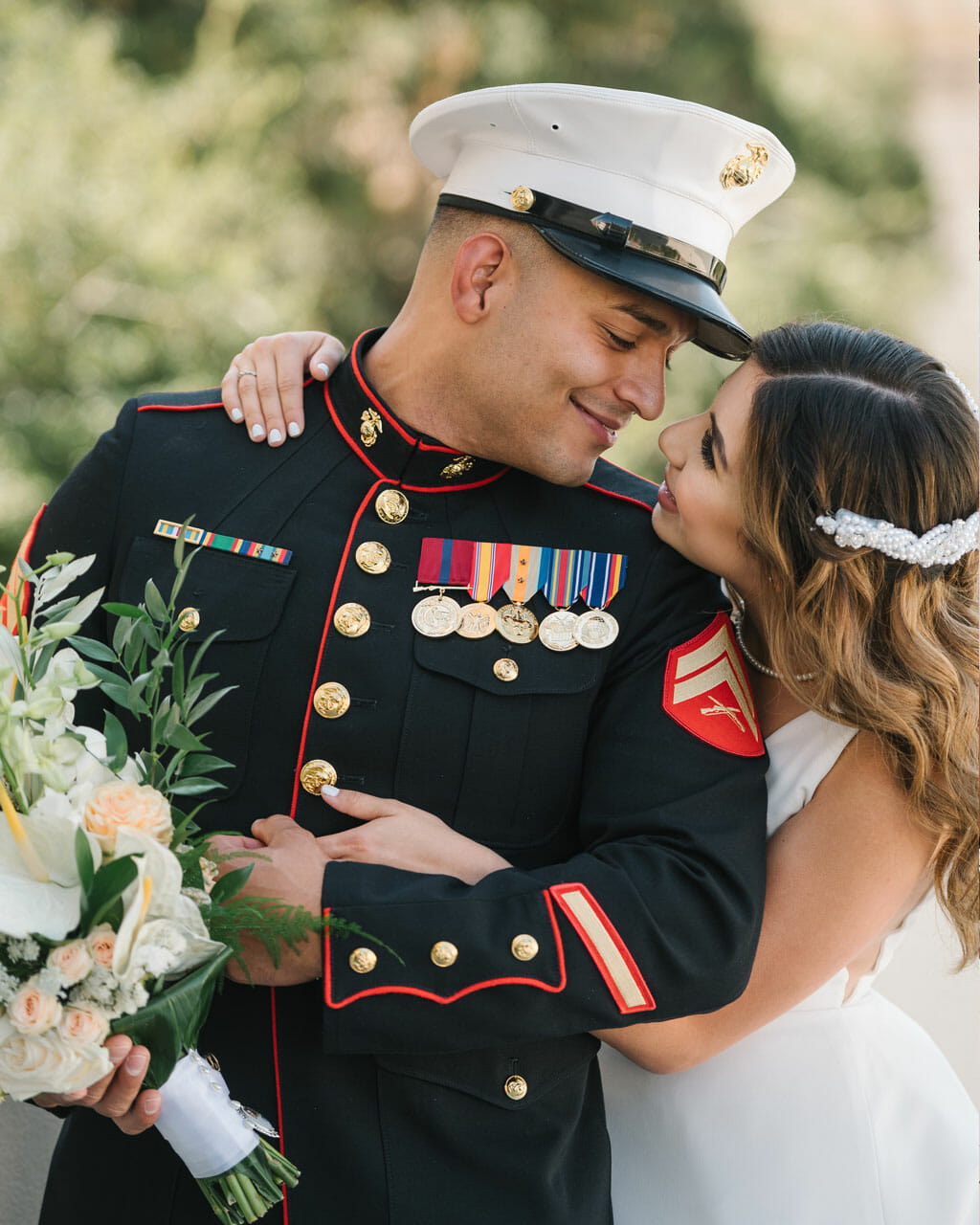 military wedding couple embracing at noor los angeles