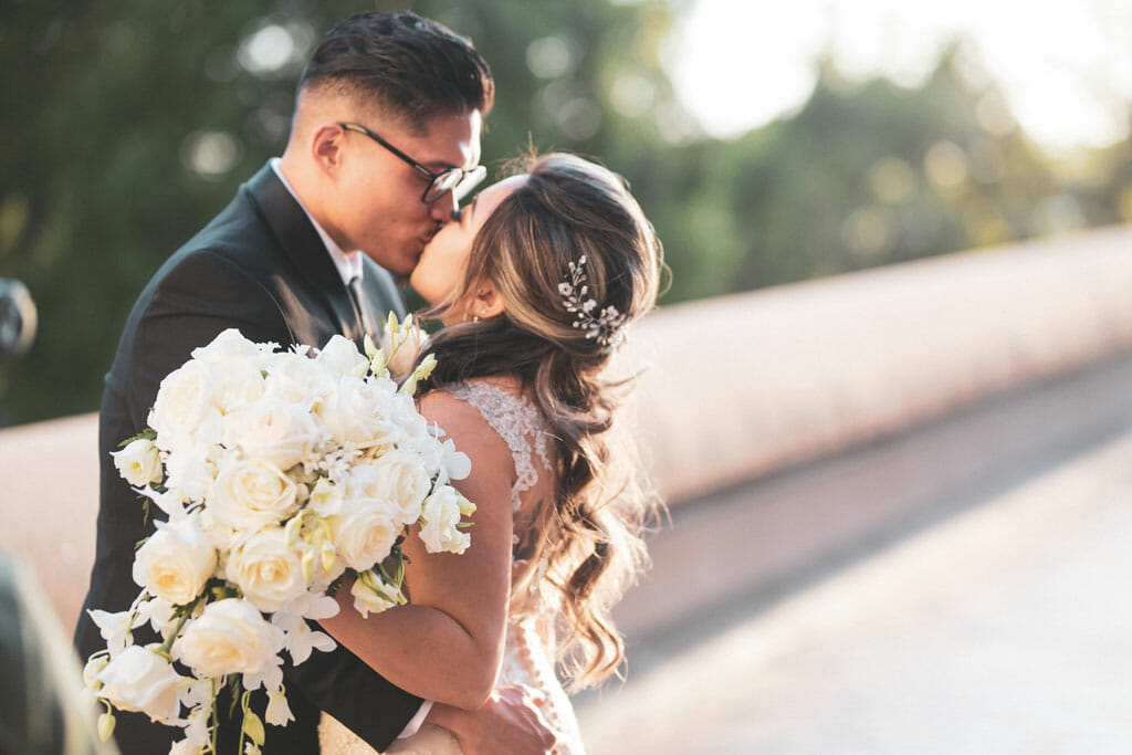 wedding couple kissing on noor banquet halls bridge to love los angeles wedding venue