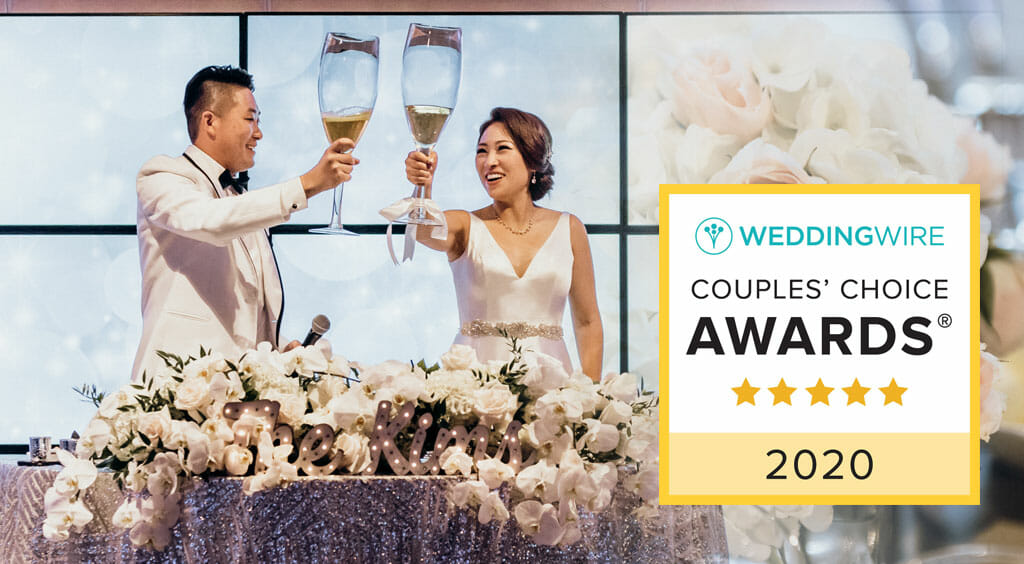 noor wedding wire couples choice award with wedding couple toasting giant glasses of champagne