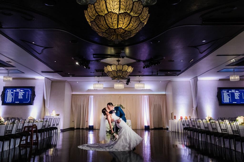 wedding couple romantic dip kiss in noor's sofia banquet hall
