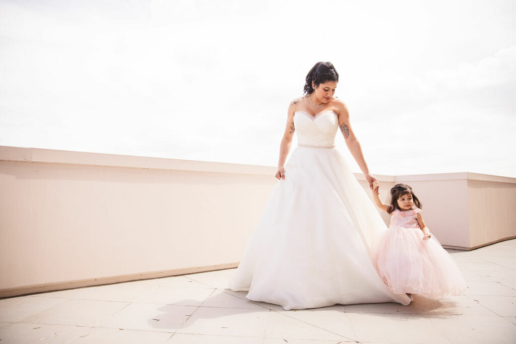Bride with her little girl taking a walk in Pasadena before wedding ceremony