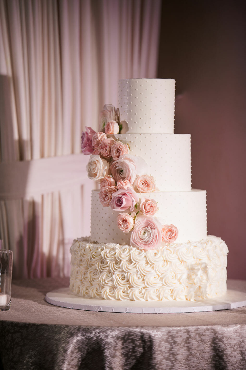 blush wedding cake with floral design