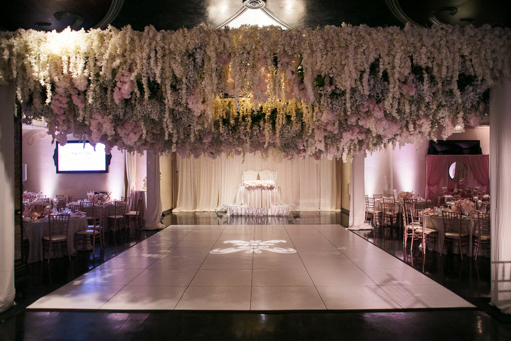 los angeles banquet hall at noor with hanging floral ceiling by shawna yamamoto