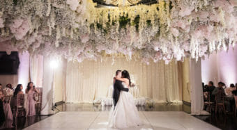 romantic first dance under a floral canopy at noor's sofia banquet hall