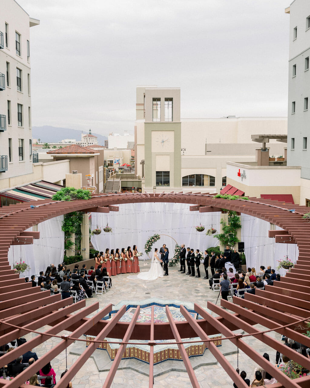 birds eye view of an outdoor wedding ceremony taking place on the NOOR terrace