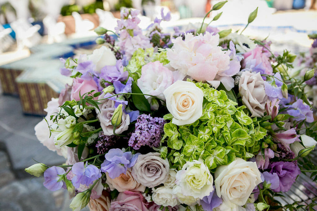 flower arrangement with purple, pink and white at outdoor wedding ceremony on the NOOR terrace