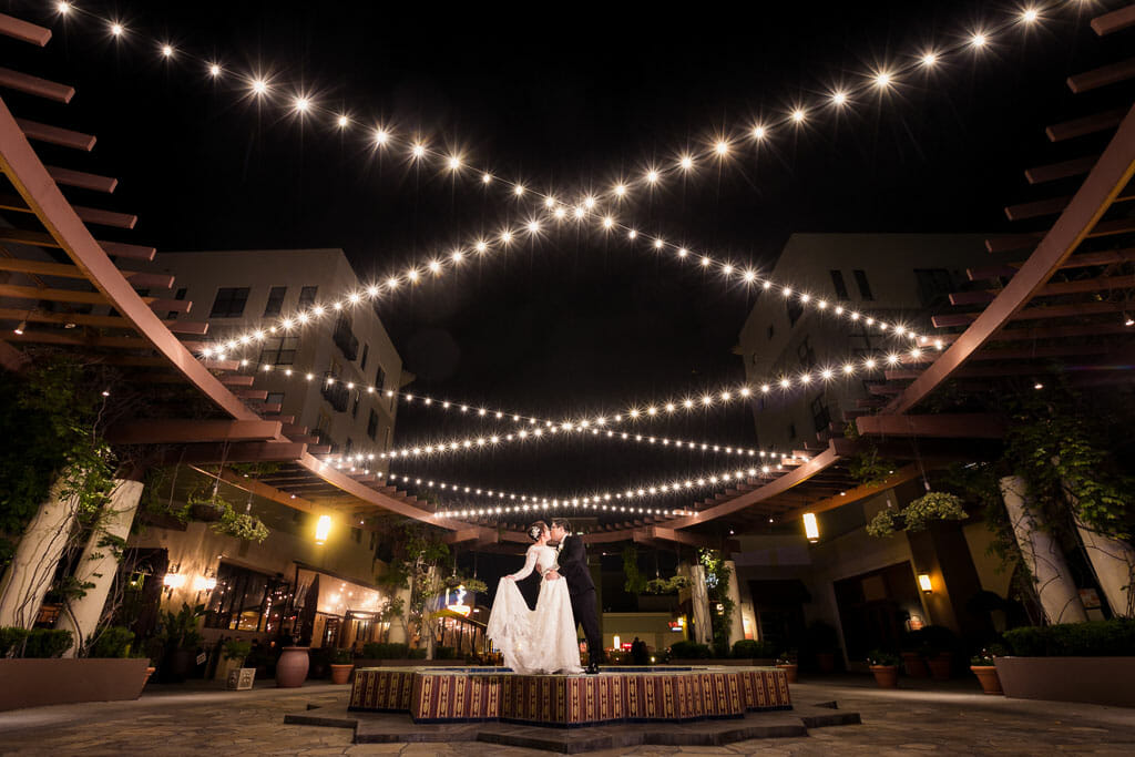 romantic bride and groom portrait on the NOOR terrace at night with string lighting
