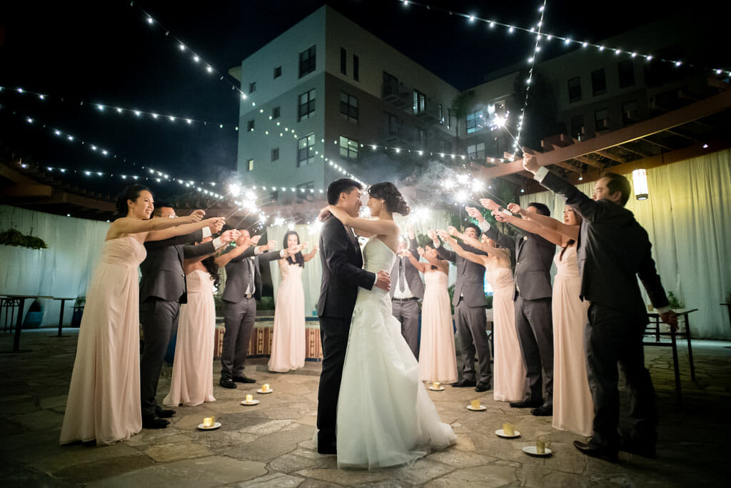 outdoor wedding sparkler exit with bride and groom kissing on the NOOR terrace